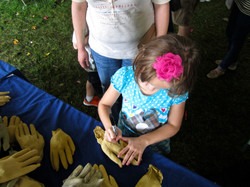 Child writing on glove at Farmaid 9:13.jpg