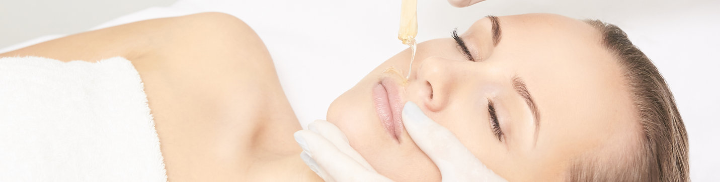 Sugar hair removal from woman body. Wax