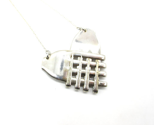 Fork necklace.