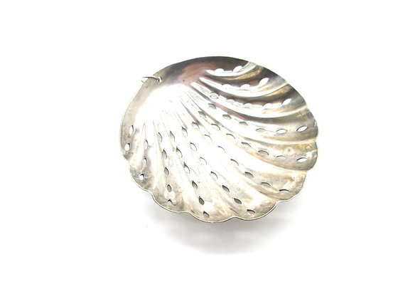 Strainer spoon necklace.