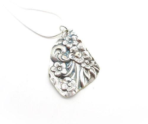 Silverware tray necklace.