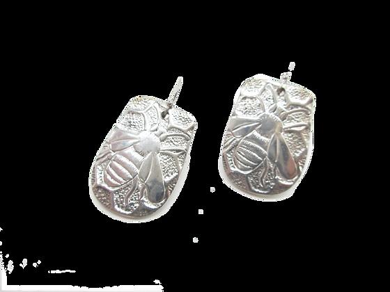 Spoon handle earrings.