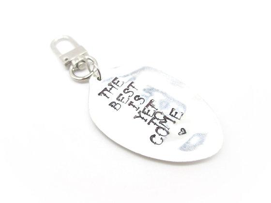 Stamped keychain.