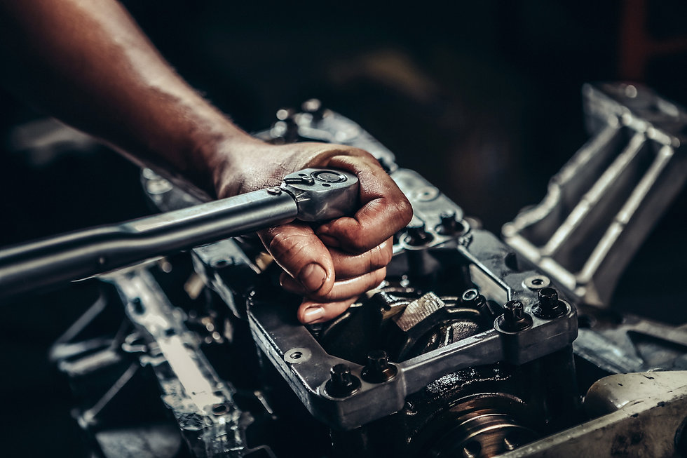 mechanic completing engine repair.jpg