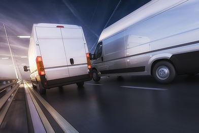 Vans in motion on motorway.jpg
