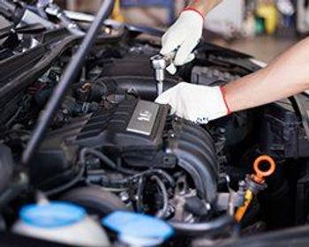 mechanic working on an engine.jpg