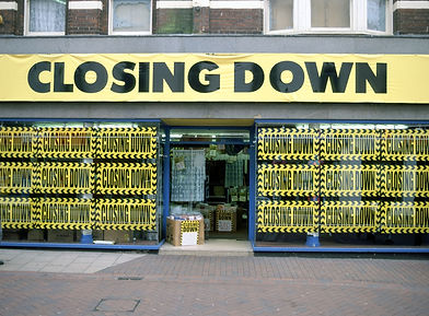 shop covered in closing down posters.jpg