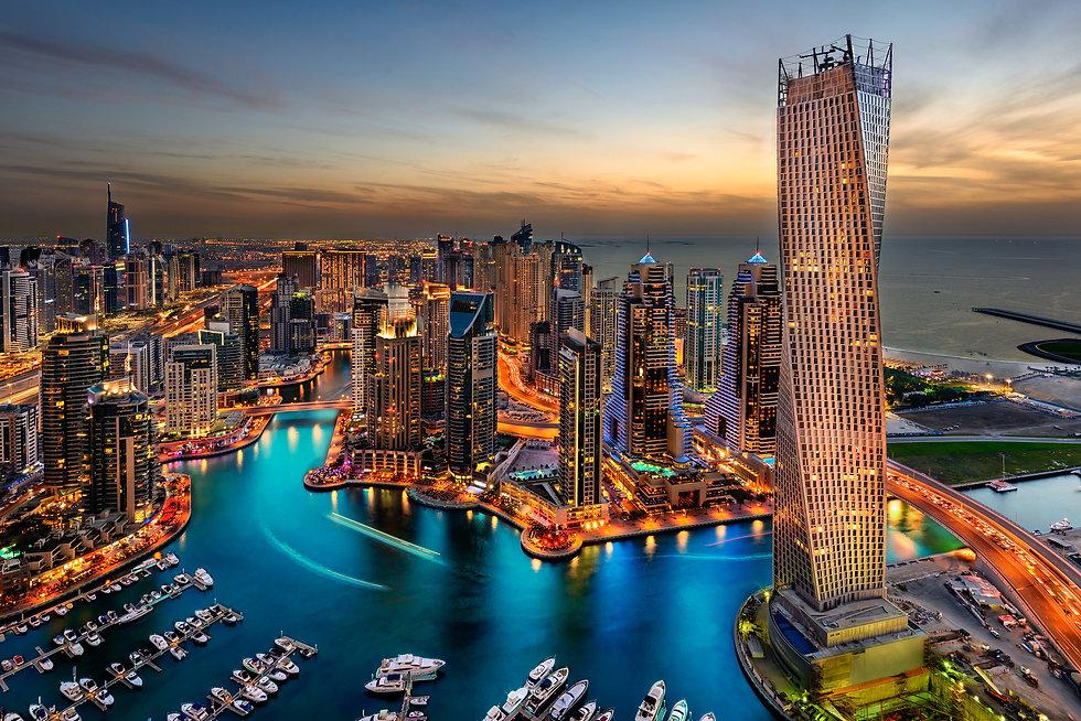 marina setting by night in Dubai