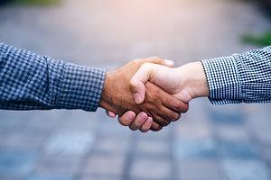 businessman shaking hands after striking deal