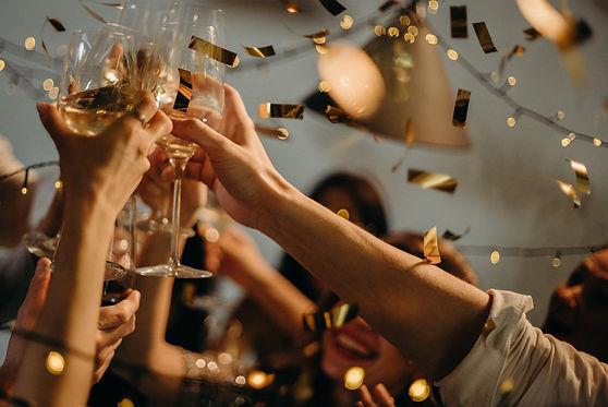 raising a glass in celebration.jpg