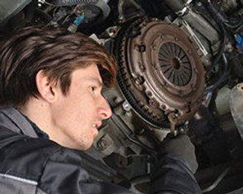 mechanic inspecting wheel assembly of ca
