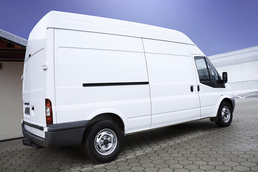 side view of a white transporter van