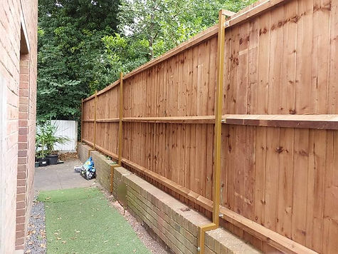 garden fence built on a low wall.jpg