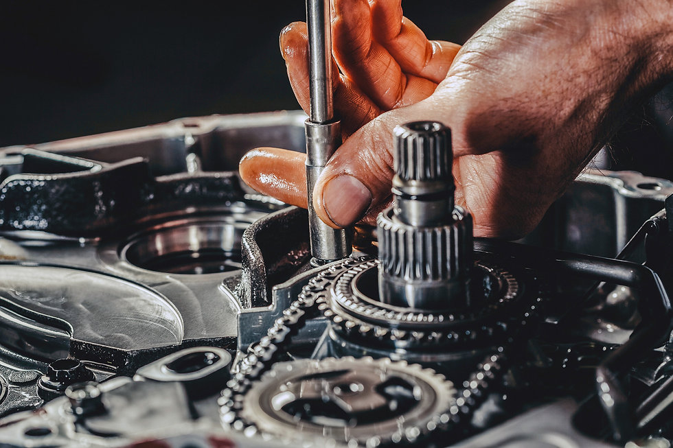 mechanic working on a gearbox assembly