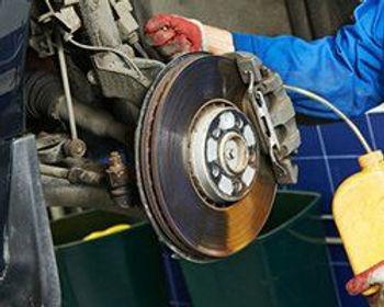 mechanic working on a brake assembly.jpg