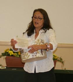 Raffle winners being read out by Ms Rebecca Peek_