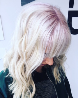 Bright white blonde with dusty violet roots!
