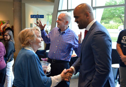 Colin talks with supporter at debate
