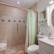 Frangipani Villa master bath with tile s