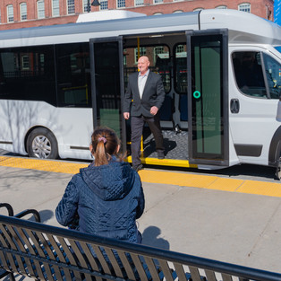 stepping off bus cropped more -77.jpg