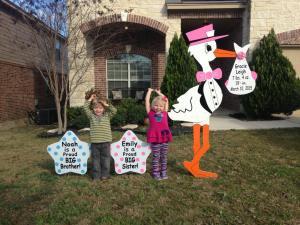 stork sign, yard, children
