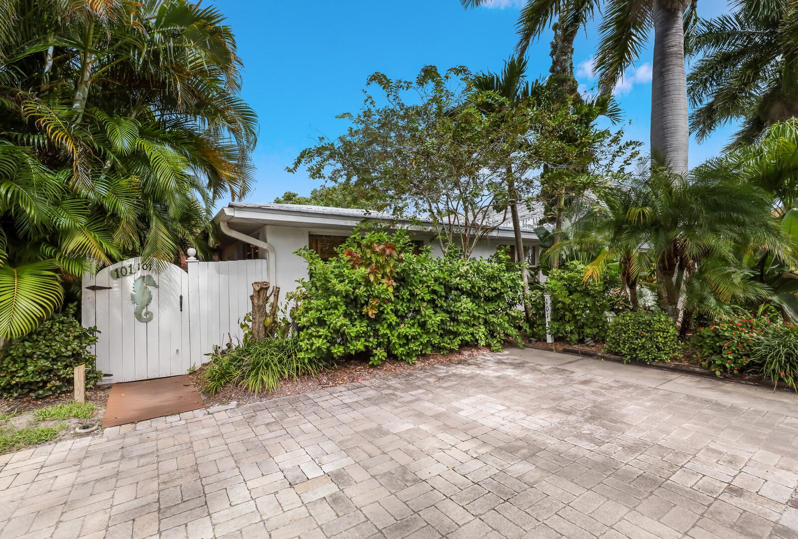 Palm Villa parking and back patio door