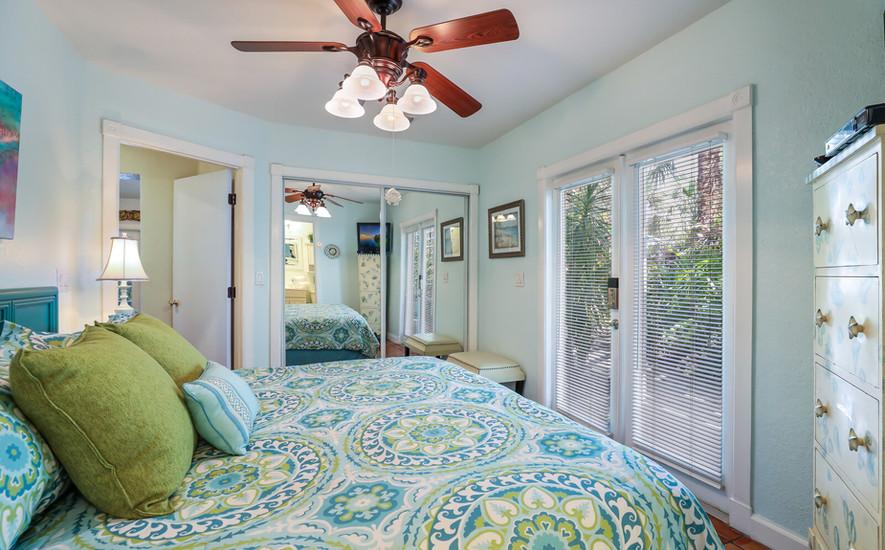 Orchid Villa King bed and doors to court