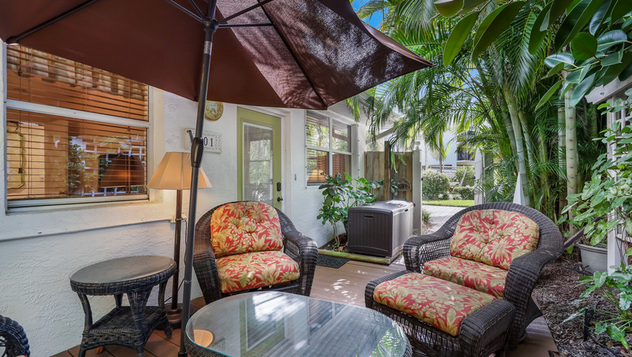 Palm Villa patio umbrella and chairs