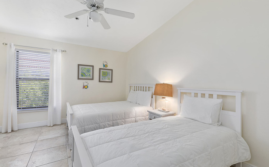Guest bedroom with full size bed and twin