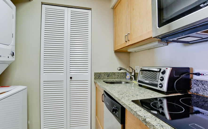 Well appointed kitchen and laundry area