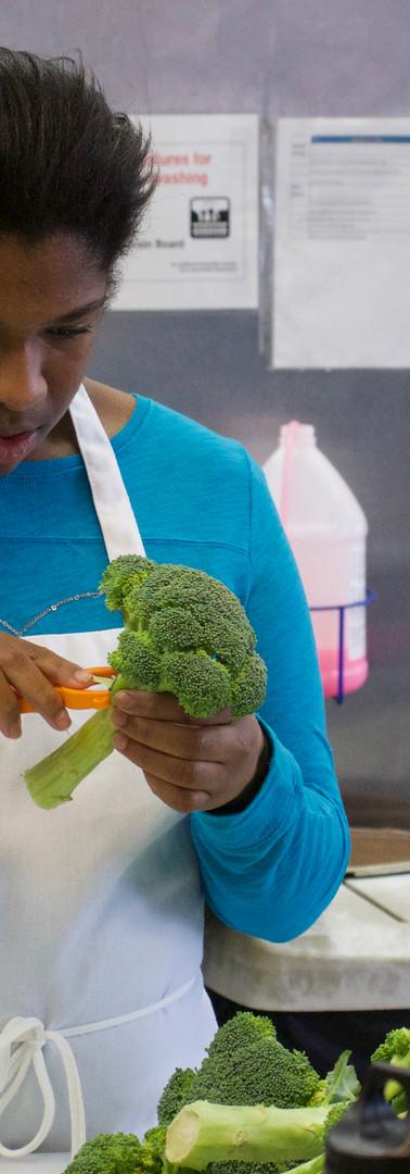 Making a tasty broccoli salad.
