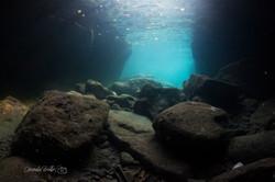 Swim through cave.