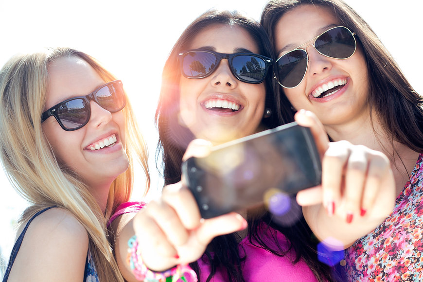 Outdoor portrait of three friends taking
