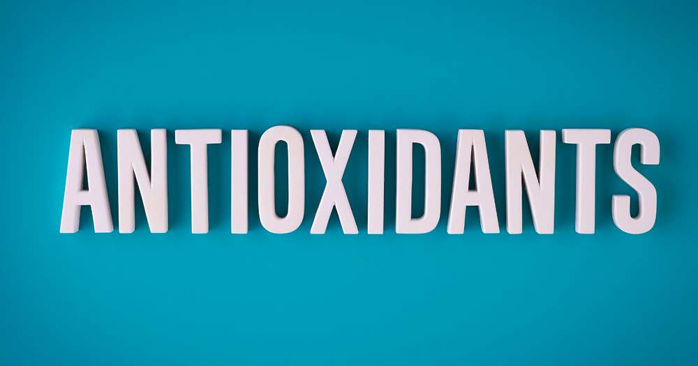 """The word """"antioxidants"""" in white block letters laying against a turquoise background."""