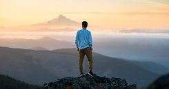man-standing-on-mountain-CR.jpg