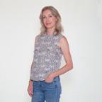 Suzi wearing a block printed sleeveless blouse