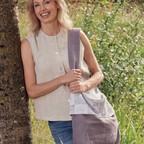 Suzi with a cuff bag