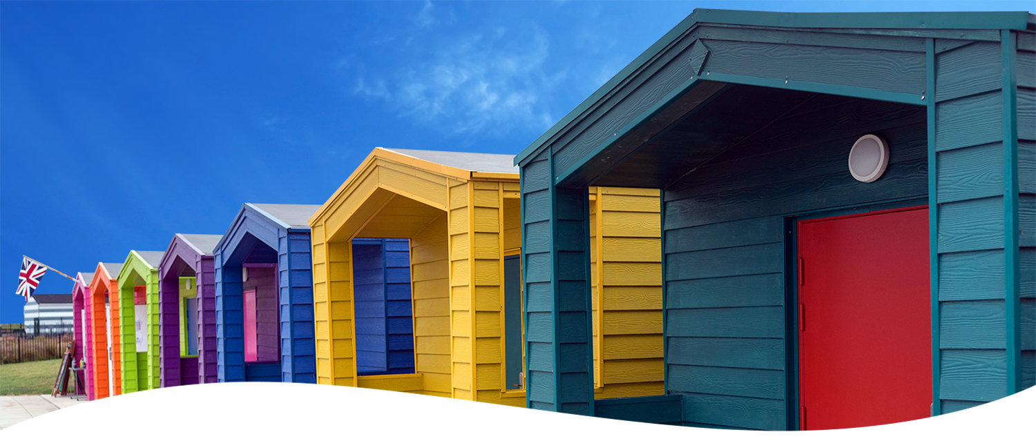 Colourful Beach Huts Banner rgb.jpg