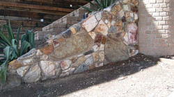 Custom stonework outdoor feature wall in