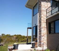 Outdoor feature column wall built by Sou