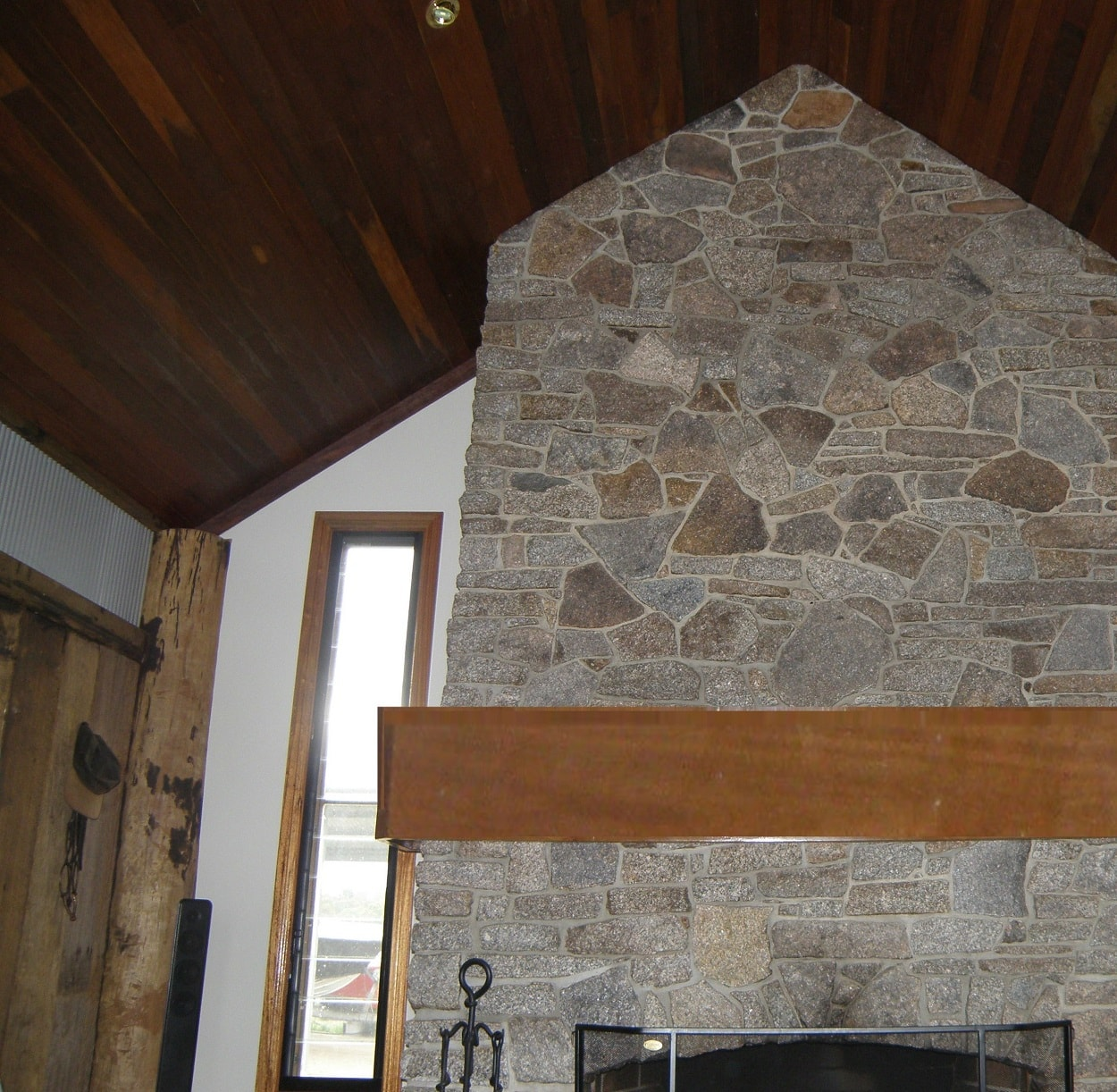 Stone fireplace and mantlepiece by Tomak