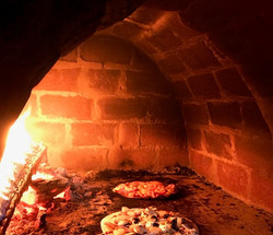 Inside a pizza oven built by Tomakin bri