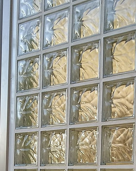 Glass bricks create an accent and let th