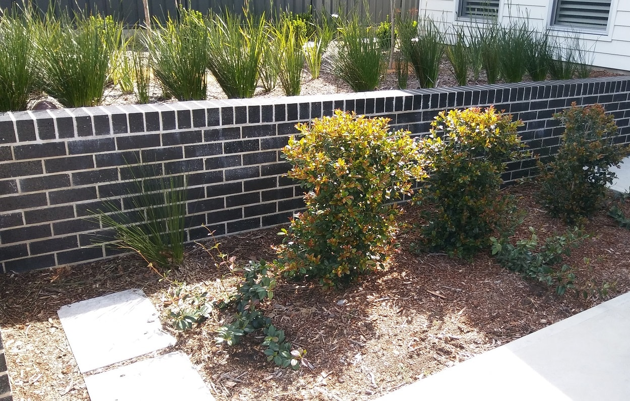 Garden brick retaining wall Broulee