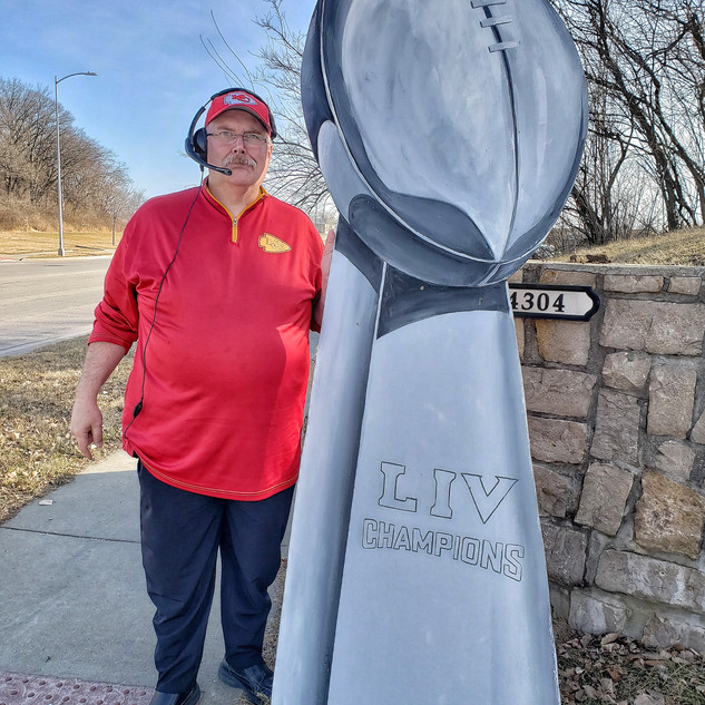 Coach Reid with the trophy