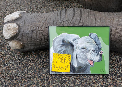 Left the painting by the big elephant