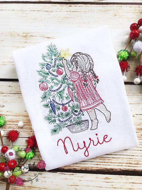 Girl Placing Star on Tree Christmas Shirt
