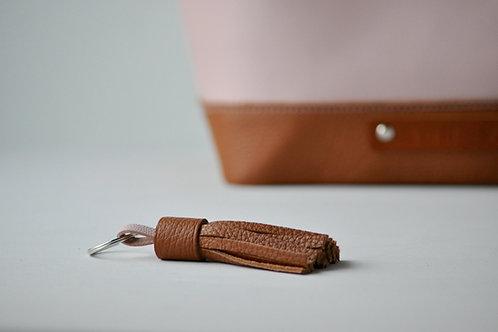 Een tassel bij je tas