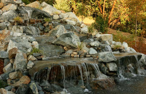 Water can really finish an area, multiple products come together to create a beautiful waterfall.