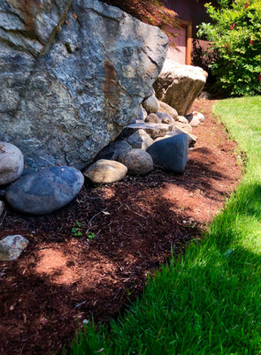 A large boulder can anchor a portion of your yard.